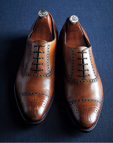 Pair of burnished calfskin leather cap-toe shoes with subtle decorative perforations