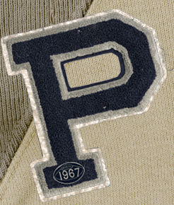 "Close-up of embroidered ""P"" patch."
