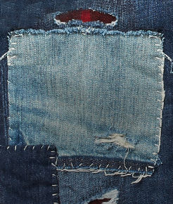 Close-up of ripped-and-repaired denim.