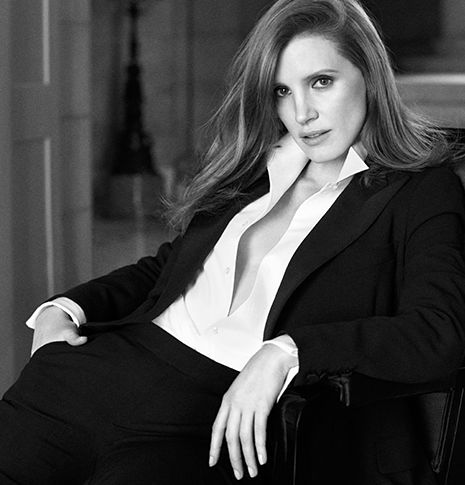 Greyscale image of Jessica Chastain in suit; bottle of Woman by Ralph Lauren.