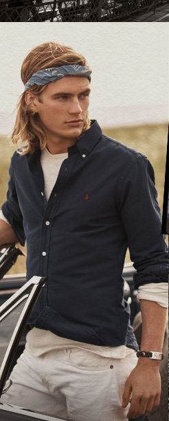 Model in navy button-down worn over white long-sleeve tee