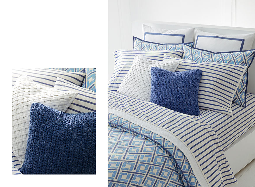 Navy & striped throw pillows paired with blue diamond-print duvet