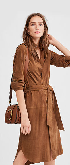 Woman in tan suede wrap dress