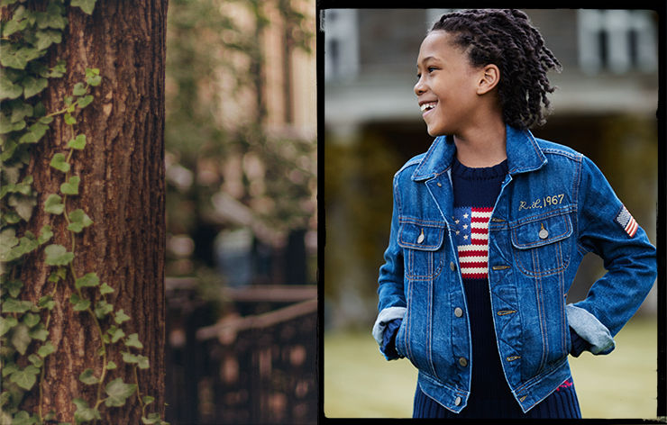 Tree with ivy; boy wearing denim jacket over American flag sweater.