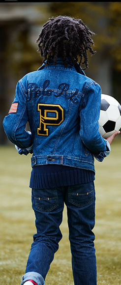 Boy wears denim jacket with felt patches