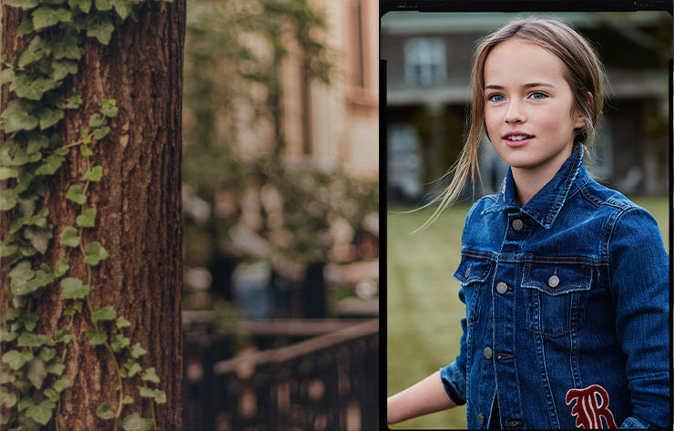 Tree with ivy; girl wears denim jacket with varsity-inspired patches.