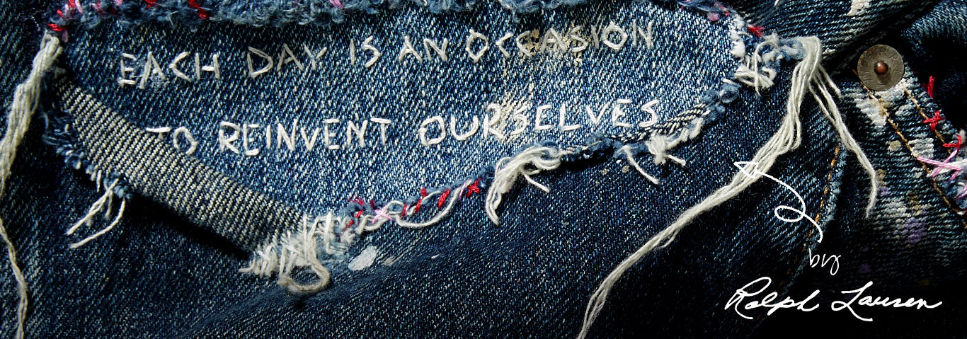 Close-up image of embroidered Ralph Lauren quote on jeans