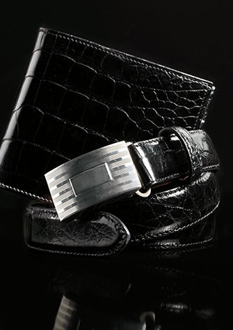 Black leather belt with engine-turned plaque buckle