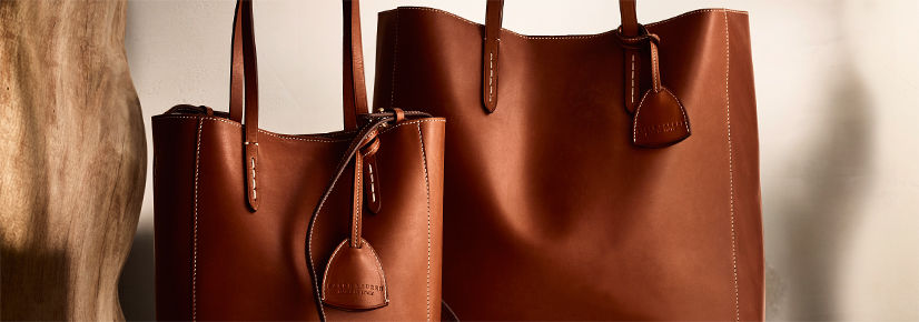 One large & one medium rich brown leather tote with matching key bells