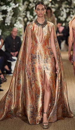 Model in lamé gown with a mosaic-inspired print & attached cape