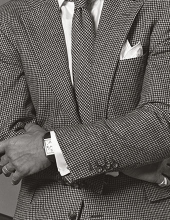 Man in checked sport coat with a crisp white pocket square