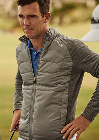 Man models mixed-media jacket accented with RLX logo
