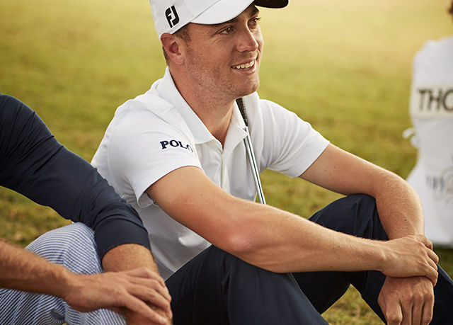 Justin Thomas sits on golf course in Polo Golf outfit