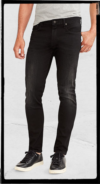 Skinny jeans in saturated black hue worn with white tee