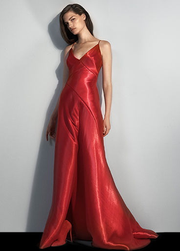 Model in red silk floor-length dress with V-neck & spaghetti straps