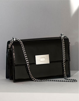 Chain strap black purse with fold-over front flap & plaque closure
